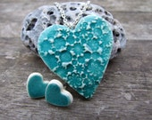 Heart pendant with turquoise crackle glaze, stamped with tiny flowers with a silver plated chain