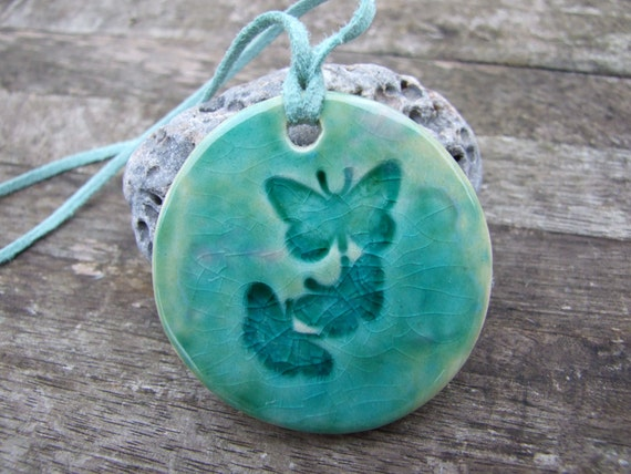 Butterfly pendant, mint green crackle glaze, blushes of pink, seafoam suede