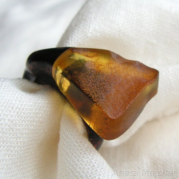 Wooden ring with natural honey baltic amber Unique jewelry Wood in black colors and stone