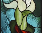 Stained glass window panel in blue,green, brown, and clear