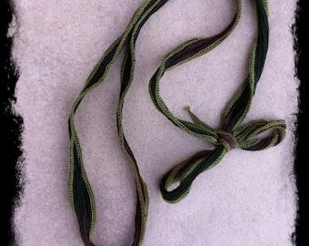 Hand Dyed Green Ribbon Charm Necklace with Smokey Quartz, Swarovski Crystal and Brass Hamsa Hand Charms