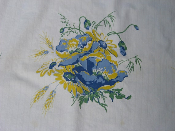 Vintage tablecloth with a floral design in blue and yellow