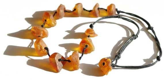 Baltic Amber Necklace. Unpolished light red amber beads 336