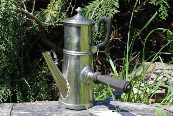 Shiny vintage French metal coffee pot with black wooden handles