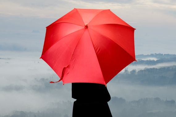 The Girl With the Big Red Umbrella