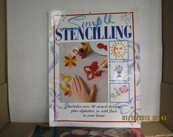 Stenciling Book with stencils inside to use used 30 page book