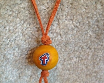orange bead with cross