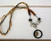 Necklace, Pebble, Bone and sterling silver, on colored hemp