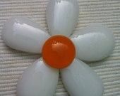 Chunky white daisy pendant with an orange centre.