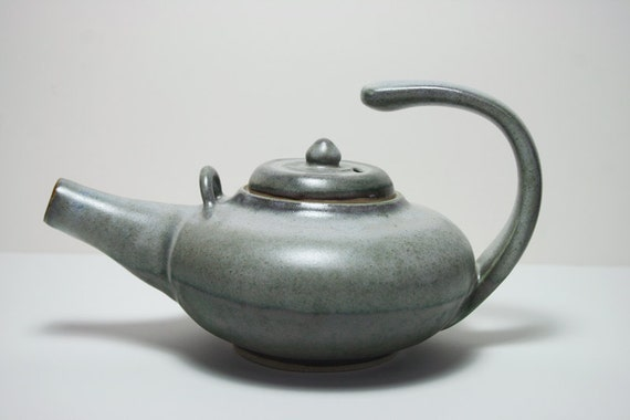 Floating handle teapot in two tone green