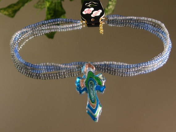 Beaded Cross Necklace. Shimmering Glass Cross Pendant on a reversable and adjustable beaded Necklace with Lobster Clasp.