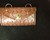 Small Leather Handbag, a clutch with a strap