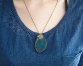 Translucent teal agate geode slice rock pendant necklace on 20 inch brass chain