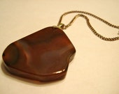 Natural earthy red brown agate geode slice rock pendant necklace on 22 inch copper chain