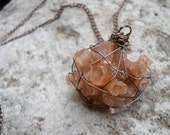 Orange brown wire-wrapped aragonite star cluster rock stone mineral geode necklace on 24 inch copper chain