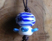 blue and white lampwork bead pendant