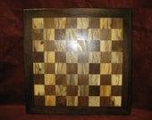solid hardwood chessboard