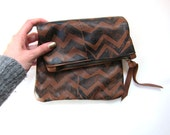Medium brown and black hand-printed leather zig zags fold-over clutch