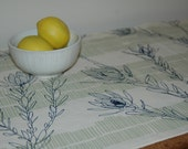 hand made table runner screen printed in leuca print on raw organic cotton
