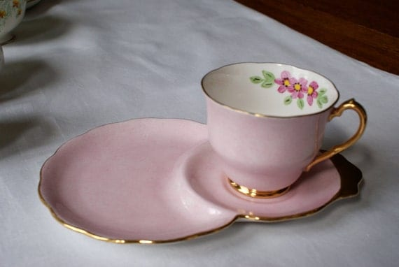 Pink and floral tea cup and saucer