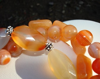 Carnelian, red agate, and aventurine triple strand bracelet
