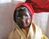 Rare Vintage Hand crafted Hatian girl doll in traditional national dress. Haiti dark skin porcelain face.