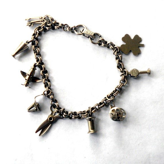 1950's KENT Signed Charm Bracelet with Moving Charms Airplane Scissors Wagon Clover