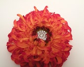 Orange flower with rhinestone center perfect for the holidays