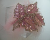 Pink jeweled headband perfect for the holidays.