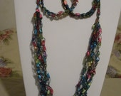 Beautiful rainbow colored crocheted necklace and earring set