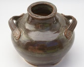 brown ceramic vase decorative