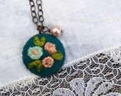 03 The Ingrid:  embroidered pendant with flowers on turquoise background and pearl