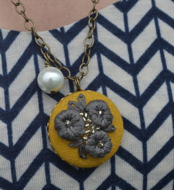 03 Hand embroidered pendant: gray flowers on mustard background