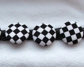 button bracelet with black and white check buttons on a black organza ribbon