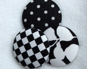 Big  black and white buttons. 3 1 1/2 in covered buttons in black and white dots, squares and flowers