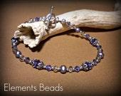 Silver & the sparkle of Tanzanite colored crystal with dyed to match pearls.  Perfect for jeans or a little black dress.