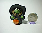 Halloween polymer clay witchy hag with pumpkin
