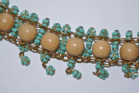 Vintage boho bracelet made of wood and flower plastic beads