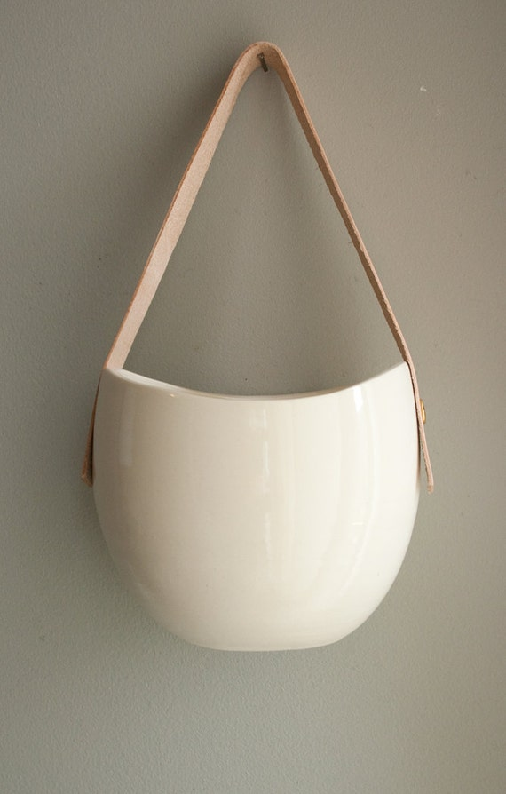 large porcelain and leather hanging container
