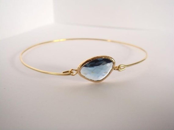 Blue montana faceted glass and gold bangle