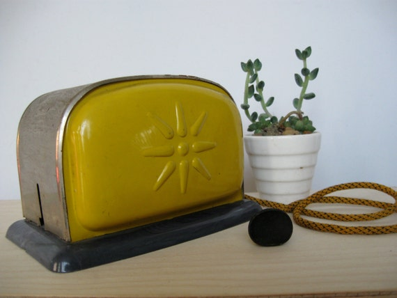 Sweet yellow vintage toy toaster