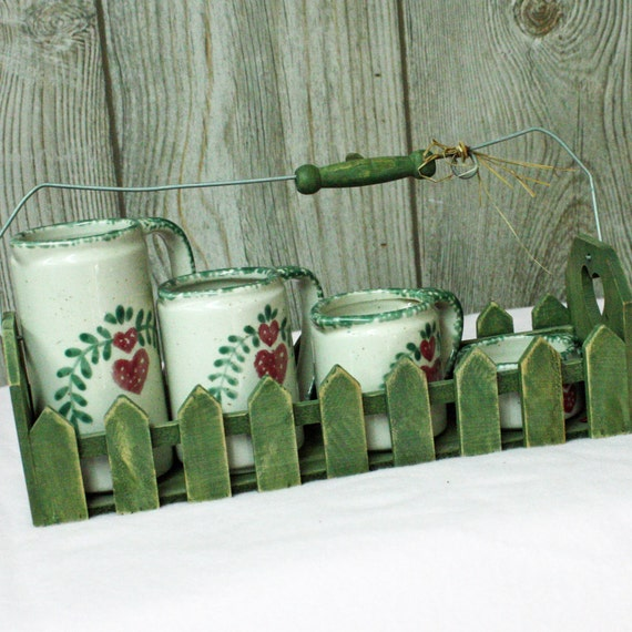Vintage Measuring  Cup Set,  With Hearts In Wooden Holder.