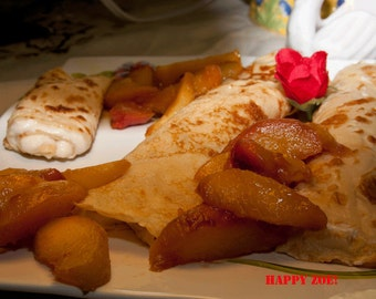 Vegan Crepes filled with organic creamy soy coconut cheese and roasted peaches, love, animal free cruelty,no eggs,no dairy.