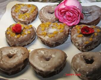 Vegan Gluten free Chocolate Heart donuts with vanilla glaze and roasted orange skin,  love, animal free cruelty,no eggs,no dairy.