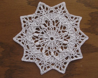 Small round 5 1/2 inch white doily 99 96