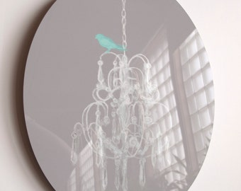 """PRETTY classy BIRD... An Illustration of a teal bird perched upon a white chandelier Infused onto a 14"""" High Gloss Metal Oval"""