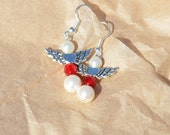 Crystal pearl beads with red faceted crystal beads and pewter wings earrings