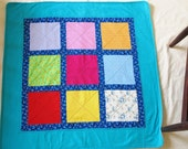 SALE! everything must go! 9 patch baby quilt, crib blanket, backed with soft fleece and aqua border.