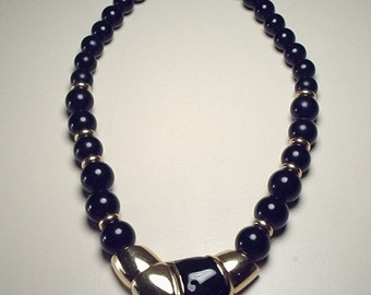 Necklace by Napier with black and gold beads