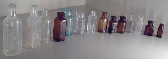Apothecary bottles, collection of 14 and all for one money